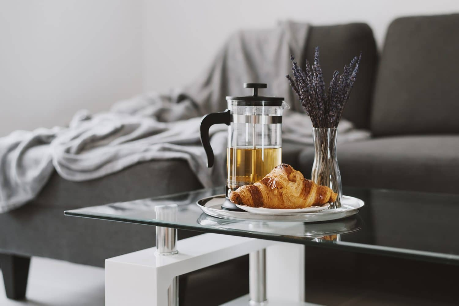 Fresh Croissant And French Press Pot With Brewed Herbal Tea And